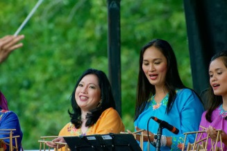 """Sept. 14, 2013 – Members of the House of Angklung orchestra, of Washington D.C., perform at the first ever New England Indonesian Festival in Copley Square in Boston. """"We want to make sure that we offer the best performers out there for the audience, so we fly people in from D.C., L.A., and New York,"""" said Gemma Ivana Miranda, the president of PERMIAS Massachusetts, a non-profit organization of Indonesian students studying in Massachusetts, who brought the festival together. Miranda is from Jakarta, the capital of Indonesia, and is studying Marketing Communication at Emerson College. """"It's a dream came true for me. I live on Newbury Street, so I often pass Copley Square on my way to school, and there were countless times when I thought how awesome it'd be to hold a huge event at this gorgeous park. My friends made me a proud leader, and they surely made the whole country proud,"""" she said of her experience bringing the festival together. Photo by Lisa Dukart."""