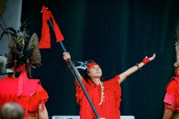 """Sept. 14, 2013 – Members of the Tomohon New Hampshire perform during the opening ceremony at the New England Indonesian Festival in Copley Square in Boston. The festival, which was brought together by PERMIAS Massachusetts, a non-profit organization of Indonesian students studying in Massachusetts, """"is based on movements of fighting roosters and is usually held during cultural ceremonies or greeting important guests. They're war dancers from the Minahasa tribe, North Sulawesi,"""" said Gemma Ivana Miranda, a member of PERMIAS Massachusetts. Photo by Lisa Dukart."""