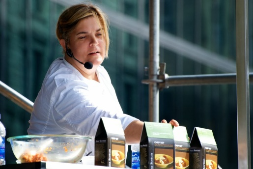 Oct. 5, 2013–Chef Ana Sortun of Oleana, a restaurant in Cambridge, reaches for her chef set to give to audience members during the Let's Talk About Food Festival in Boston's Copley Square. Photo by Lisa Dukart.