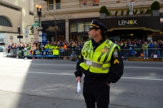 April 21, 2014--A police officer monitors the crowds just ahead of the Boston Marathon finish line on Boylston Street. Photo by Lisa Dukart.